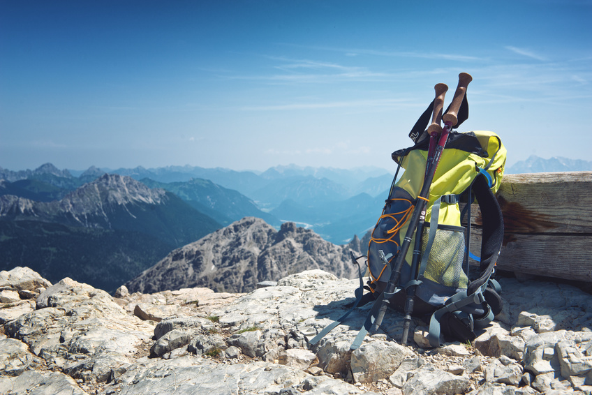 Backpack on top of a summit in the Alps